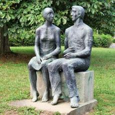 Skulptur Sitzendes Paar
